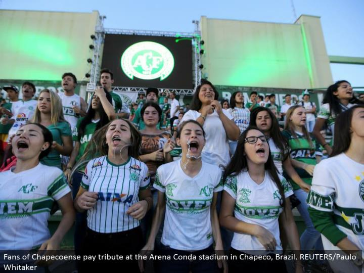 Fans of Chapecoense pay tribute at the Arena Conda stadium in Chapeco, Brazil. REUTERS/Paulo Whitaker