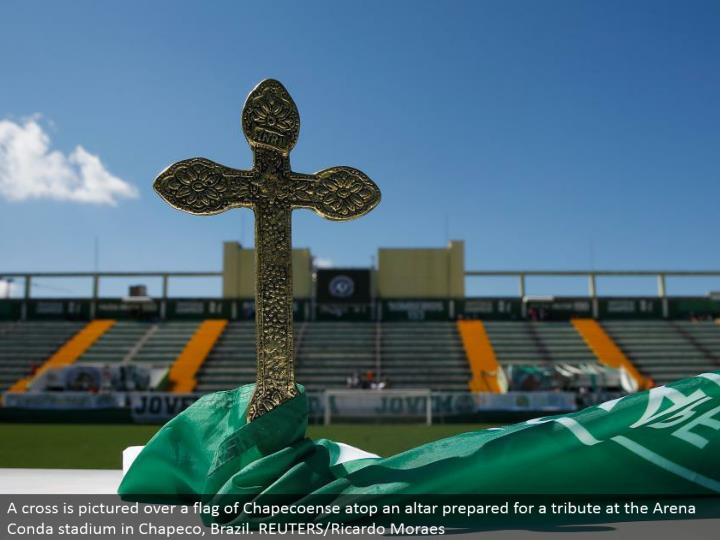 A traverse a banner of Chapecoense on a holy place arranged for a tribute at the Arena Conda stadium in Chapeco, Brazil. REUTERS/Ricardo Moraes