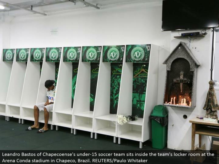Leandro Bastos of Chapecoense's under-15 soccer group sits inside the group's locker room at the Arena Conda stadium in Chapeco, Brazil. REUTERS/Paulo Whitaker