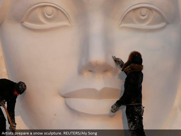 Artists set up a snow form. REUTERS/Aly Song