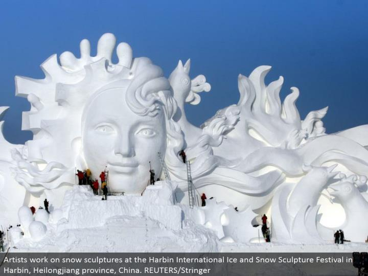 Artists work on snow figures at the Harbin International Ice and Snow Sculpture Festival in Harbin, Heilongjiang region, China. REUTERS/Stringer