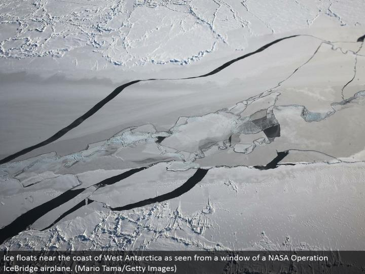 Ice skims close to the shore of West Antarctica as observed from a window of a NASA Operation IceBridge plane. (Mario Tama/Getty Images)