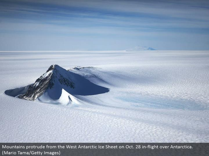 Mountains distend from the West Antarctic Ice Sheet on Oct. 28 in-flight over Antarctica. (Mario Tama/Getty Images)