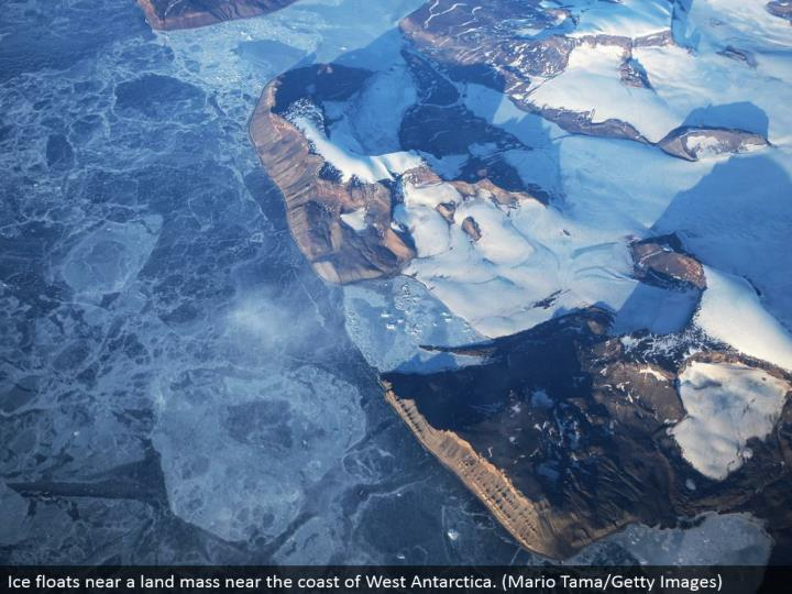 Ice skims close to a land mass close to the shoreline of West Antarctica. (Mario Tama/Getty Images)