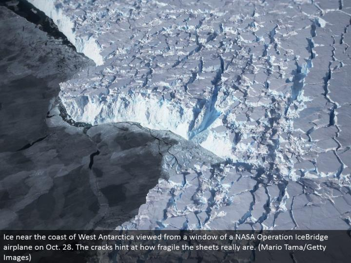 Ice close to the shoreline of West Antarctica saw from a window of a NASA Operation IceBridge plane on Oct. 28. The breaks allude to how delicate the sheets truly are. (Mario Tama/Getty Images)