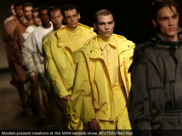 Models introduce manifestations at the MAN catwalk appear. REUTERS/Neil Hall
