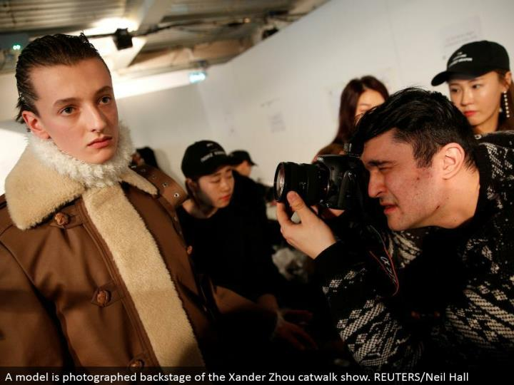 A model is captured backstage of the Xander Zhou catwalk appear. REUTERS/Neil Hall