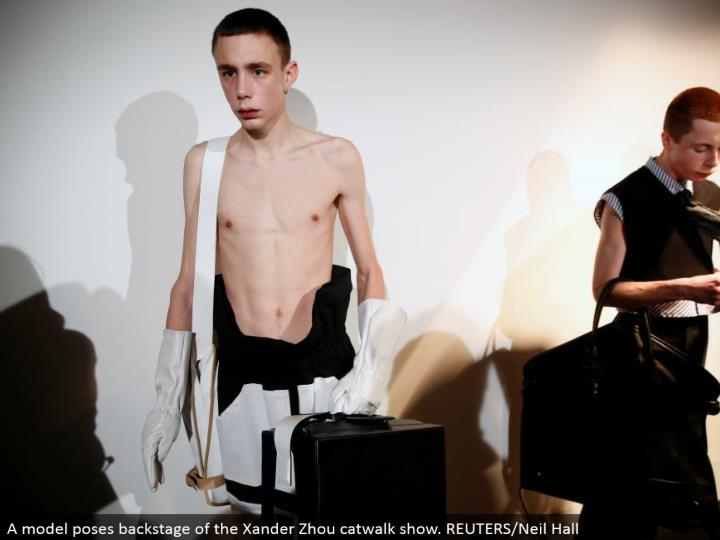 A display postures backstage of the Xander Zhou catwalk appear. REUTERS/Neil Hall