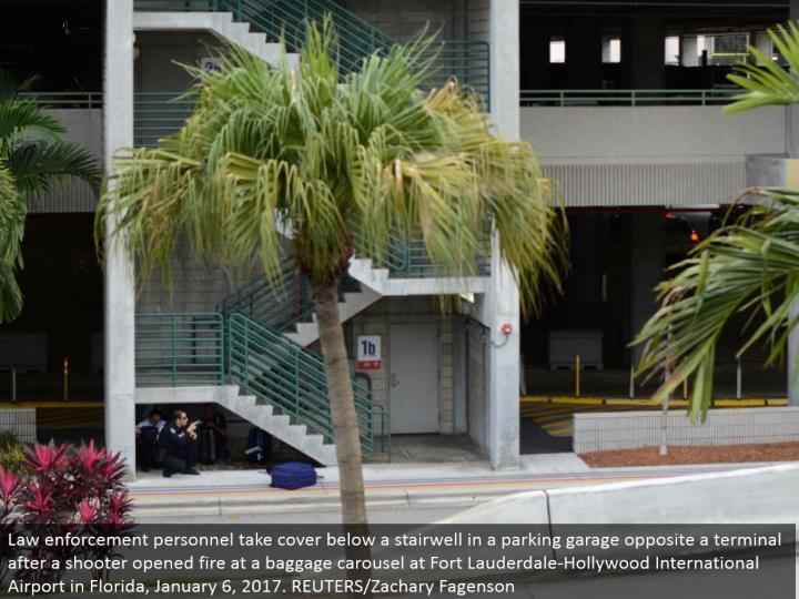 Law requirement work force hide underneath a stairwell in a parking structure inverse a terminal after a shooter opened fire at a baggage claim at Fort Lauderdale-Hollywood International Airport in Florida, January 6, 2017. REUTERS/Zachary Fagenson