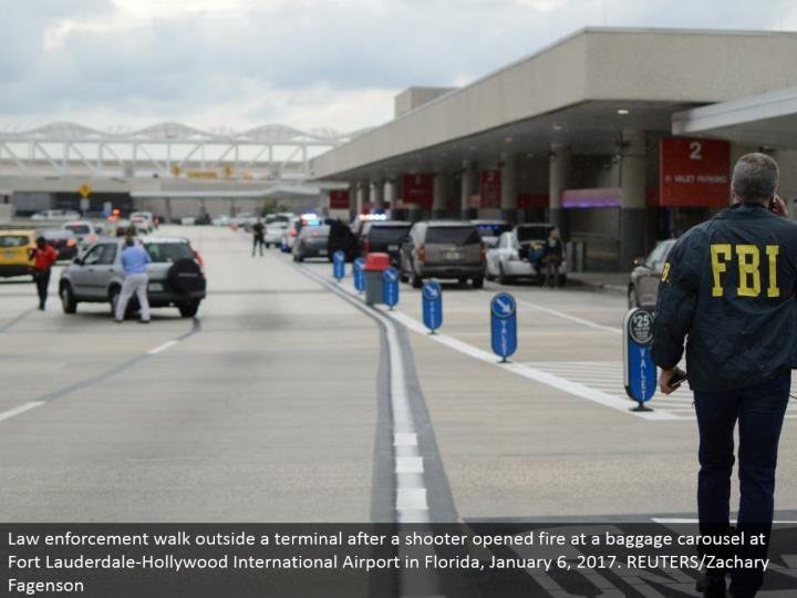 Law requirement stroll outside a terminal after a shooter opened fire at a baggage claim at Fort Lauderdale-Hollywood International Airport in Florida, January 6, 2017. REUTERS/Zachary Fagenson
