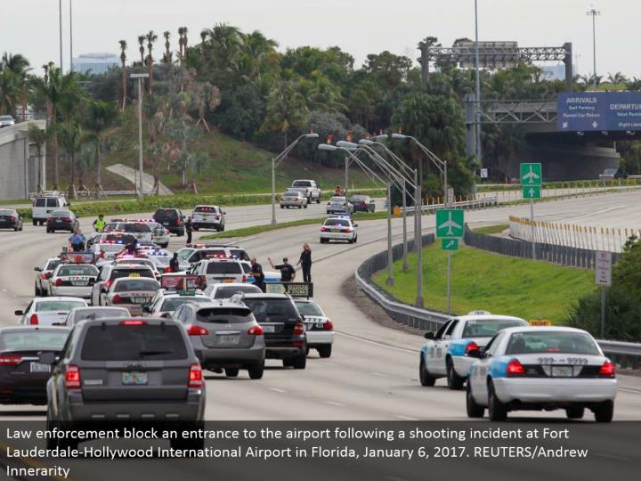 Law implementation hinder a passageway to the air terminal after a shooting occurrence at Fort Lauderdale-Hollywood International Airport in Florida, January 6, 2017. REUTERS/Andrew Innerarity