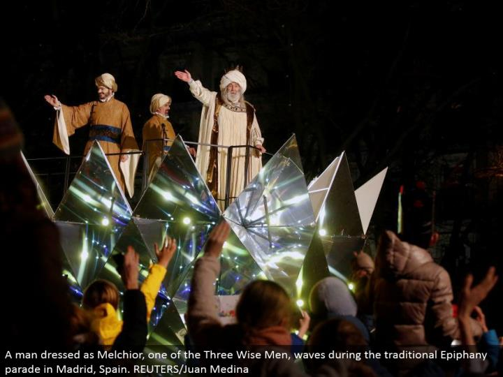 A man dressed as Melchior, one of the Three Wise Men, waves amid the conventional Epiphany parade in Madrid, Spain. REUTERS/Juan Medina