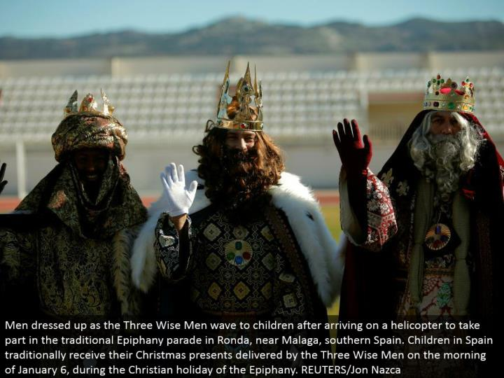 Men spruced up as the Three Wise Men wave to kids in the wake of touching base on a helicopter to participate in the customary Epiphany parade in Ronda, close Malaga, southern Spain. Kids in Spain customarily get their Christmas presents conveyed by the Three Wise Men on the morning of January 6, amid the Christian occasion of the Epiphany. REUTERS/Jon Nazca