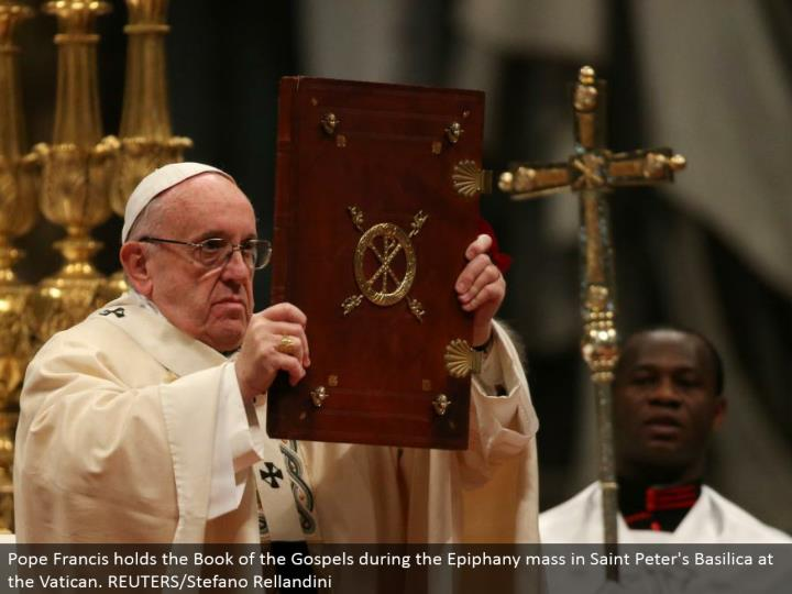 Pope Francis holds the Book of the Gospels amid the Epiphany mass in Saint Peter's Basilica at the Vatican. REUTERS/Stefano Rellandini