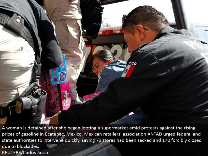 A lady is confined after she started plundering a general store in the midst of challenges against the rising costs of fuel in Ecatepec, Mexico. Mexican retailers' affiliation ANTAD encouraged government and state powers to intercede rapidly, saying 79 stores had been sacked and 170 persuasively shut because of bars.  REUTERS/Carlos Jasso