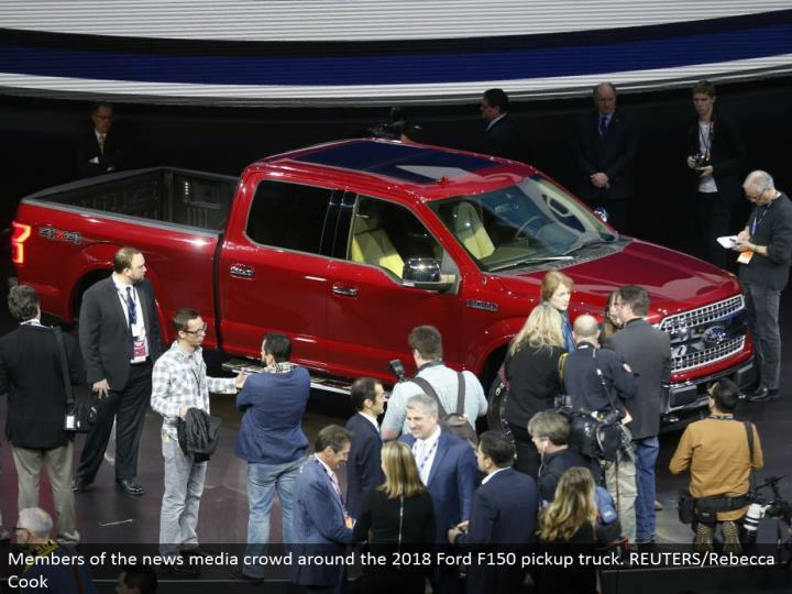 Members of the news media swarm around the 2018 Ford F150 pickup truck. REUTERS/Rebecca Cook