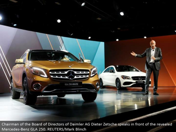 Chairman of the Board of Directors of Daimler AG Dieter Zetsche talks before the uncovered Mercedes-Benz GLA 250. REUTERS/Mark Blinch