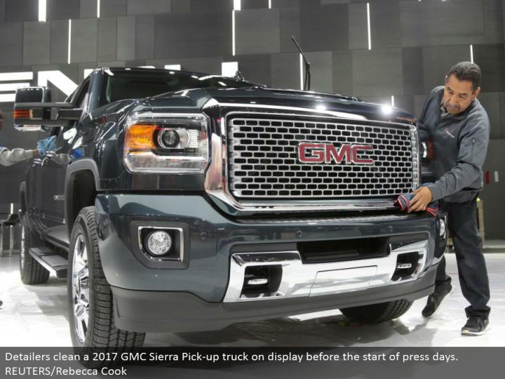 Detailers clean a 2017 GMC Sierra Pick-up truck in plain view before the begin of press days. REUTERS/Rebecca Cook