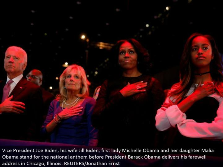 Vice President Joe Biden, his better half Jill Biden, first woman Michelle Obama and her girl Malia Obama remain for the national song of praise before President Barack Obama conveys his goodbye address in Chicago, Illinois. REUTERS/Jonathan Ernst