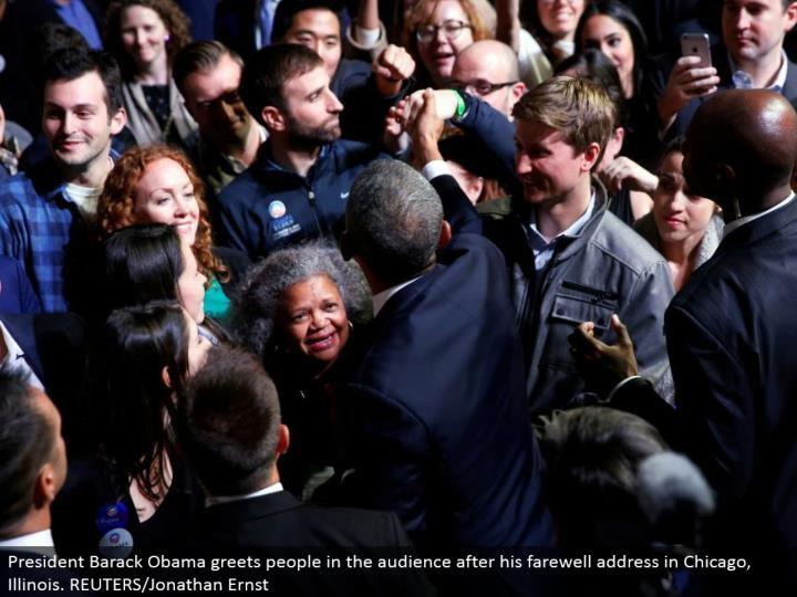President Barack Obama welcomes individuals in the group of onlookers after his goodbye address in Chicago, Illinois. REUTERS/Jonathan Ernst