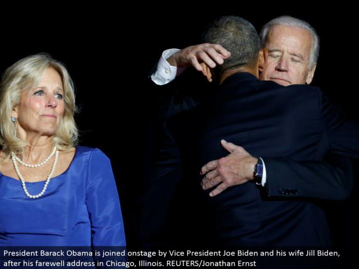 President Barack Obama is joined in front of an audience by Vice President Joe Biden and his better half Jill Biden, after his goodbye address in Chicago, Illinois. REUTERS/Jonathan Ernst