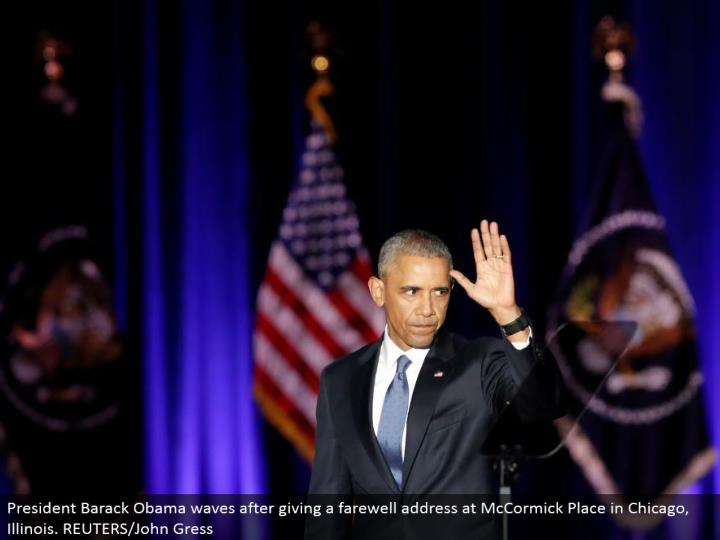 President Barack Obama waves in the wake of giving a goodbye address at McCormick Place in Chicago, Illinois. REUTERS/John Gress