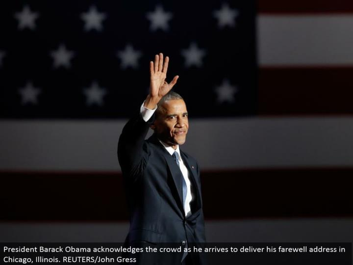 President Barack Obama recognizes the group as he touches base to convey his goodbye address in Chicago, Illinois. REUTERS/John Gress