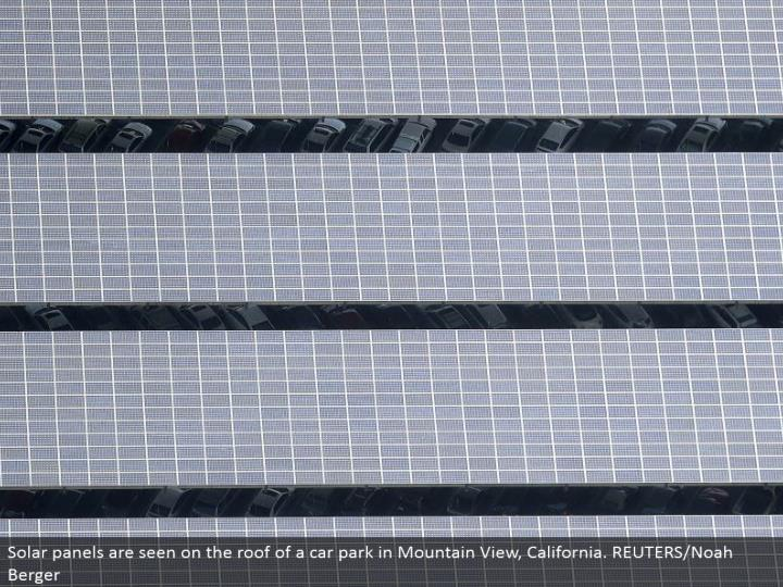 Solar boards are seen on the top of an auto stop in Mountain View, California. REUTERS/Noah Berger