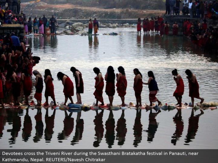 Devotees cross the Triveni River amid the Swasthani Bratakatha celebration in Panauti, close Kathmandu, Nepal. REUTERS/Navesh Chitrakar