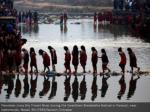 devotees cross the triveni river amid