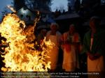 devotees remain close to a fire before washing