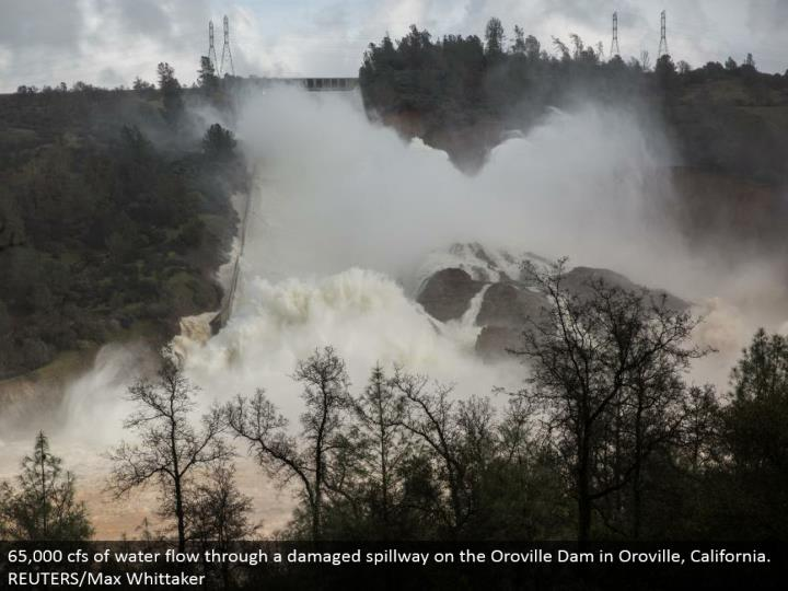 65,000 cfs of water move through a harmed spillway on the Oroville Dam in Oroville, California. REUTERS/Max Whittaker