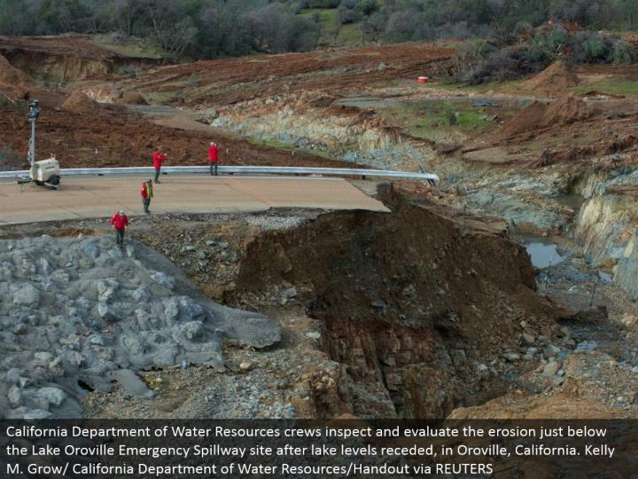 California Department of Water Resources teams assess and assess the disintegration just underneath the Lake Oroville Emergency Spillway site after lake levels subsided, in Oroville, California. Kelly M. Develop/California Department of Water Resources/Handout by means of REUTERS