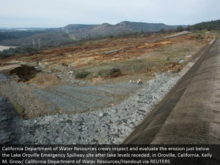 California Department of Water Resources teams assess and assess the disintegration just beneath the Lake Oroville Emergency Spillway site after lake levels subsided, in Oroville, California. Kelly M. Develop/California Department of Water Resources/Handout by means of REUTERS