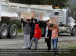 children hold signs expressing gratitude toward