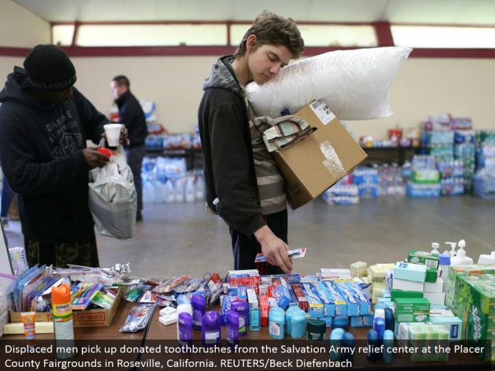 Displaced men get gave toothbrushes from the Salvation Army help focus at the Placer County Fairgrounds in Roseville, California. REUTERS/Beck Diefenbach