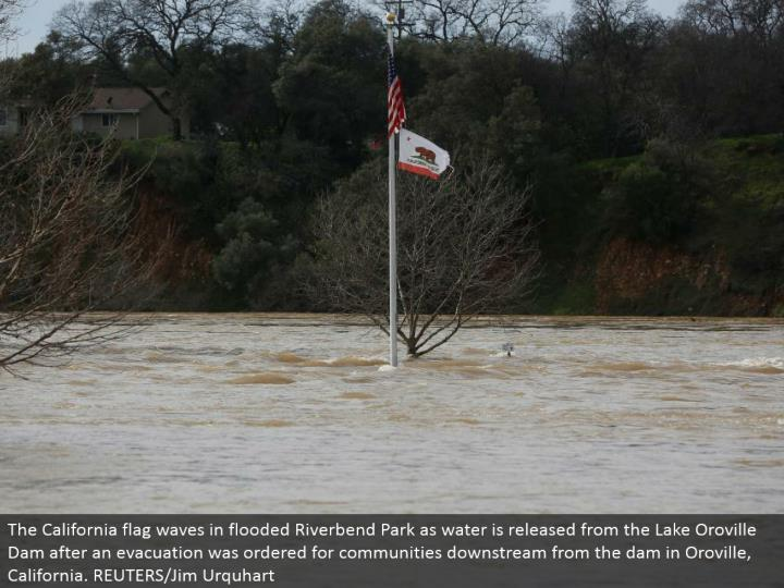 The California hail waves in overwhelmed Riverbend Park as water is discharged from the Lake Oroville Dam after a departure was requested for groups downstream from the dam in Oroville, California. REUTERS/Jim Urquhart