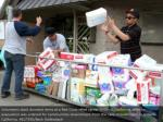 volunteers stack gave things at a red cross