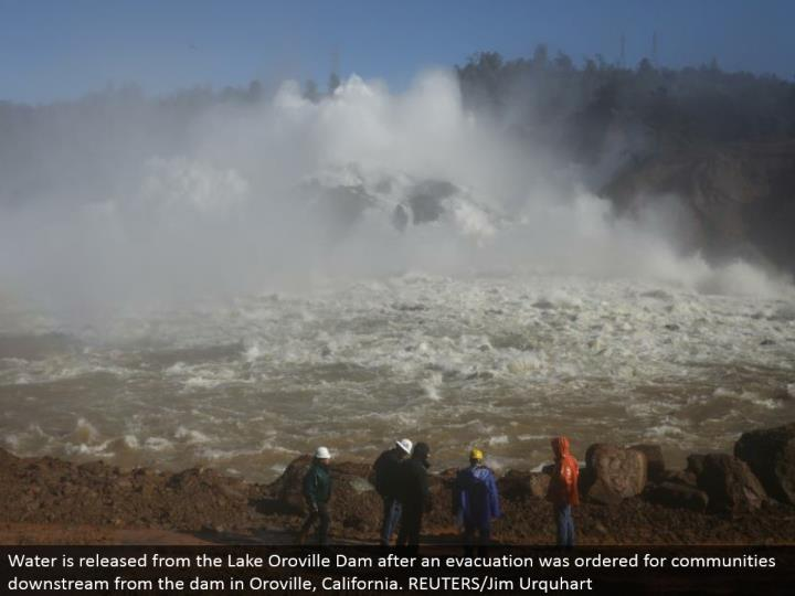 Water is discharged from the Lake Oroville Dam after a clearing was requested for groups downstream from the dam in Oroville, California. REUTERS/Jim Urquhart