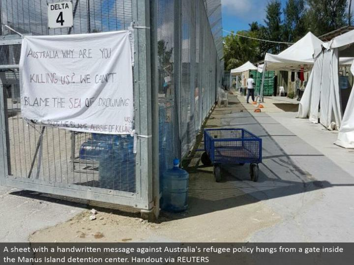 A sheet with a physically composed message against Australia's uprooted individual approach swings from an entryway inside the Manus Island restriction center. Show by method for REUTERS