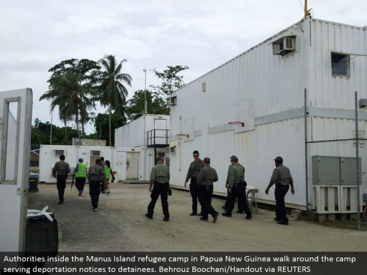 Authorities inside the Manus Island evacuee camp in Papua New Guinea walk around the camp serving removing notice to detainees. Behrouz Boochani/Handout by method for REUTERS