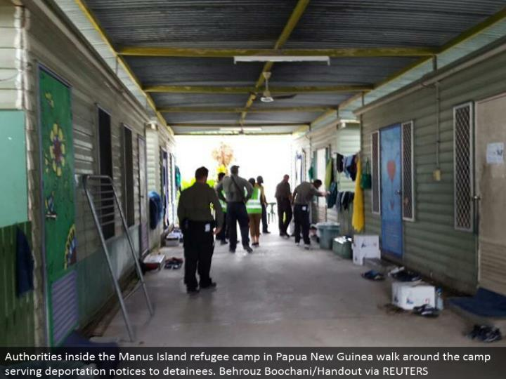 Authorities inside the Manus Island uprooted individual camp in Papua New Guinea walk around the camp serving removing notice to detainees. Behrouz Boochani/Handout by method for REUTERS