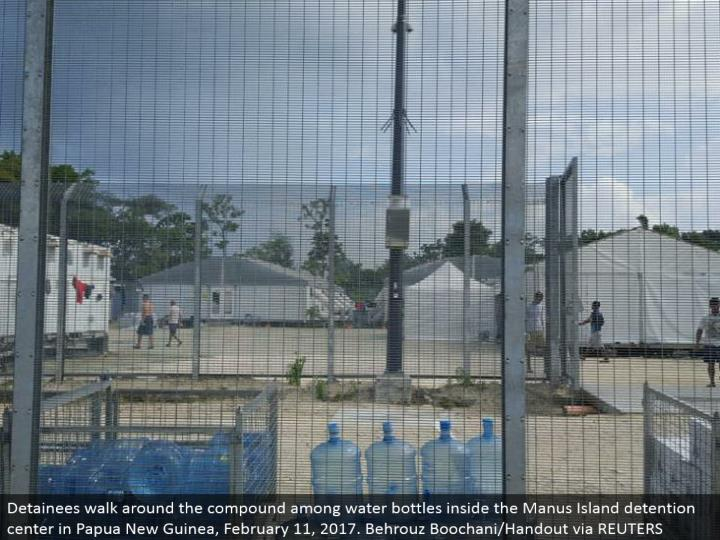Detainees walk around the compound among water bottles inside the Manus Island confinement center in Papua New Guinea, February 11, 2017. Behrouz Boochani/Handout by method for REUTERS