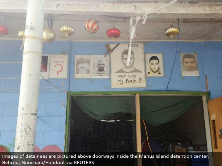 Images of detainees are introduced above gateways inside the Manus Island confinement center. Behrouz Boochani/Handout by method for REUTERS