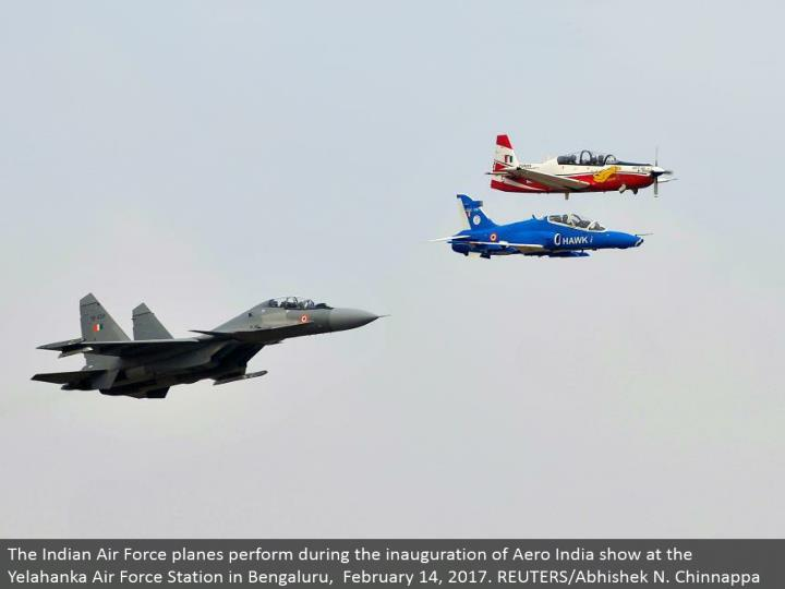 The Indian Air Force planes perform amid the initiation of Aero India appear at the Yelahanka Air Force Station in Bengaluru, February 14, 2017. REUTERS/Abhishek N. Chinnappa