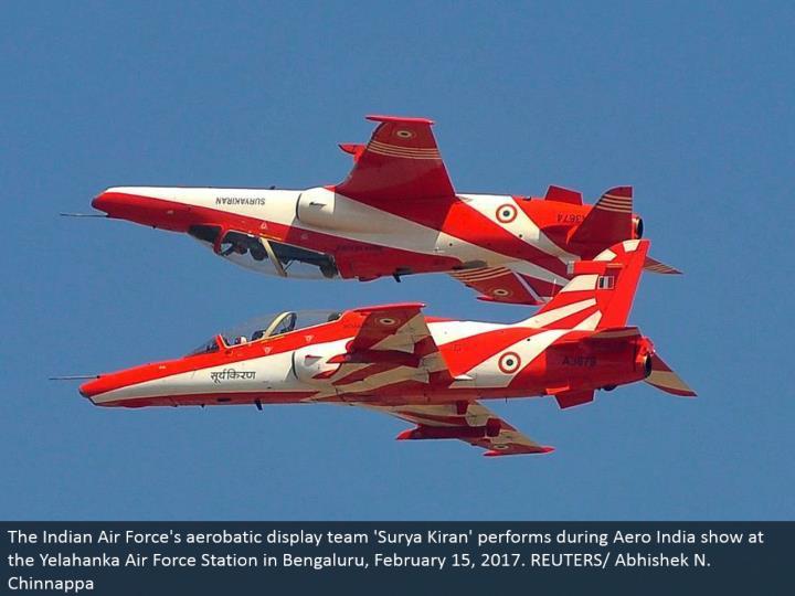 The Indian Air Force's aerobatic show group 'Surya Kiran' performs amid Aero India appear at the Yelahanka Air Force Station in Bengaluru, February 15, 2017. REUTERS/Abhishek N. Chinnappa