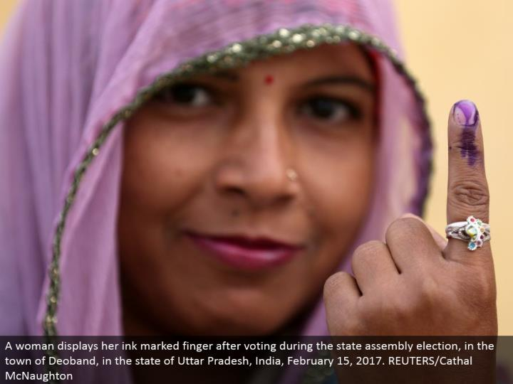 A lady shows her ink stamped finger in the wake of voting amid the state gathering decision, in the town of Deoband, in the condition of Uttar Pradesh, India, February 15, 2017. REUTERS/Cathal McNaughton