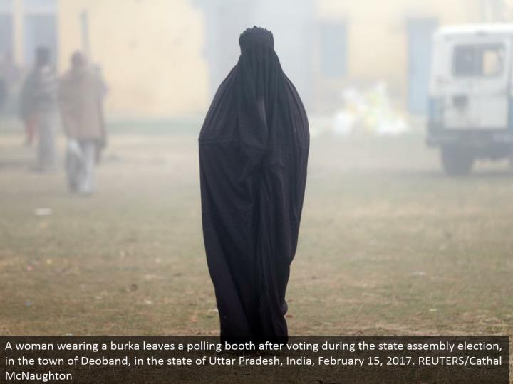 A lady wearing a burka leaves a surveying corner in the wake of voting amid the state get together race, in the town of Deoband, in the condition of Uttar Pradesh, India, February 15, 2017. REUTERS/Cathal McNaughton