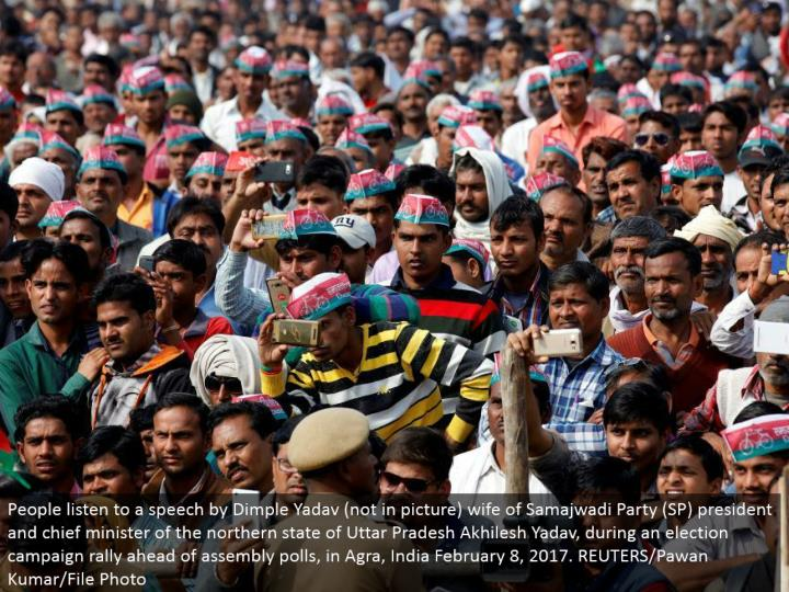 People tune in to a discourse by Dimple Yadav (not in picture) spouse of Samajwadi Party (SP) president and boss clergyman of the northern condition of Uttar Pradesh Akhilesh Yadav, amid a race battle rally in front of get together surveys, in Agra, India February 8, 2017. REUTERS/Pawan Kumar/File Photo
