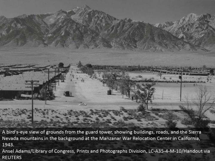 A bird's-eye perspective of grounds from the watch tower, indicating structures, streets, and the Sierra Nevada mountains out of sight at the Manzanar War Relocation Center in California, 1943. Ansel Adams/Library of Congress, Prints and Photographs Division, LC-A35-4-M-10/Handout through REUTERS